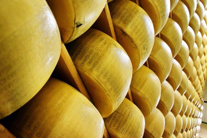 parmigiano reggiano at a market shelf. Parma, Italy
